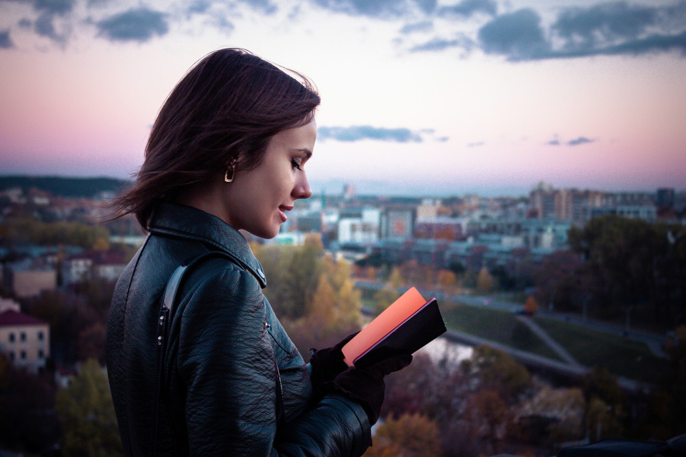 Student outside with book