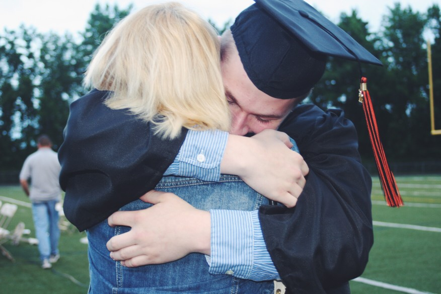 Student hugging family member at graduation