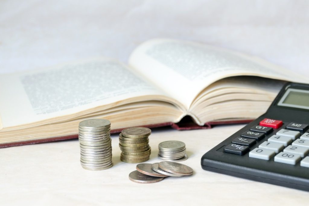 Book, coins and calculator